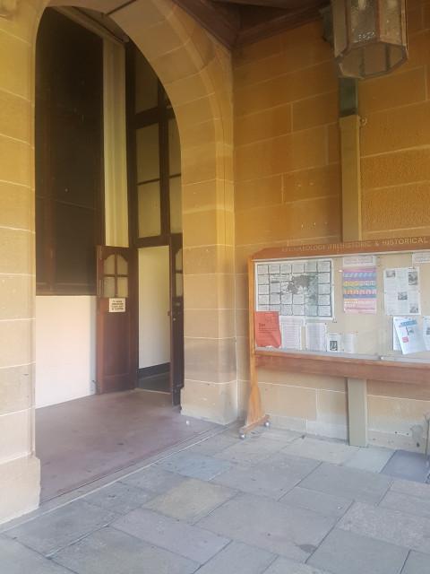Enter via this hallway next to the notice board